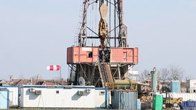 Oil drilling rig with workers stock video