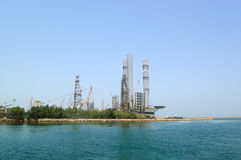 Oil drilling site at the shore Stock Photo
