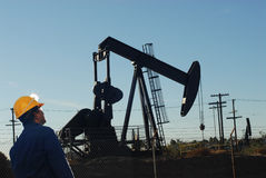 Oil drilling worker at oil field. Asian oil field worker at work Royalty Free Stock Photography
