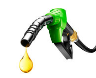 Oil Dripping From a Gasoline Pump. Isolated on white bakground Stock Image