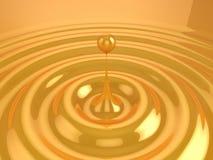 Oil drop. A Golden liquid drop, creating ripple Royalty Free Stock Photo