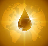 Oil drop  on Earth. Icon of drop of oil or honey Royalty Free Stock Photo