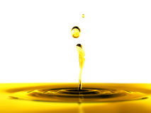 Oil drop on white background Stock Photography