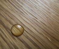 Oil drop an a wooden surface. Oil drop an a wooden oak surface Stock Photo