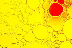 Oil drops floating in water abstract multi color background. Stock Images