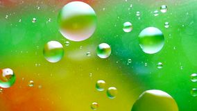 Oil drops floating stock footage