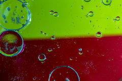 Oil drops on a water surface Royalty Free Stock Image