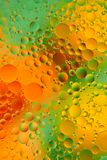 Oil drops on a water surface abstract background.  Royalty Free Stock Photo