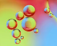 Oil drops on water surface Royalty Free Stock Photos