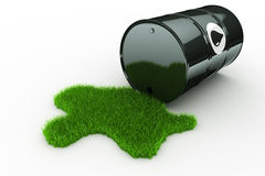 Oil drum with grass Stock Images