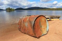 Oil drum at lake Stock Photos