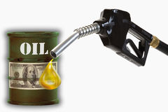Oil drum with sign of dollar note and fuel nozzle with  drop of Stock Photos