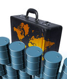 Oil drums and briefcase. New clean oil drums piled high with business briefcase and map against a white background Stock Photos