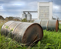 Oil Drums in grass. Oil Drums in front of factory royalty free stock images