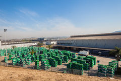 Oil Drums Storage Yard. Hundreds of two hundred liter or fifty gallon oil drums stacked in storage yard facility awaiting to be taken to final client customer Royalty Free Stock Photos
