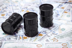 Oil drums on US dollars Royalty Free Stock Image