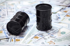 Oil drums on US dollars background Royalty Free Stock Photography