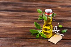 Oil with dry leaves of sage Royalty Free Stock Photos