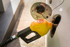 Oil E20. A white car fill fuel to oil tank at the gas station Stock Photos