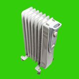 Oil electric heater Isolated on green background Stock Photo