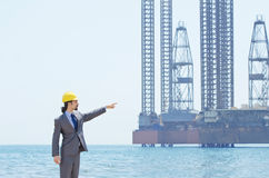 Oil engineer on sea side Royalty Free Stock Images