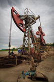 Oil exploration closeup. Oil rig pump closeup low angle view Stock Photos