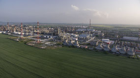 Oil factory aerial view. With chimneys oil tanks and pipe lines Royalty Free Stock Photos