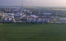 Oil factory aerial view. With chimneys oil tanks and pipe lines Royalty Free Stock Photo