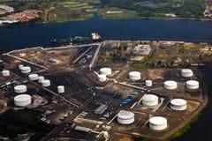 Oil farm with river Stock Photos