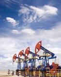 Oil field. Pump jacks on a oil field Royalty Free Stock Photo