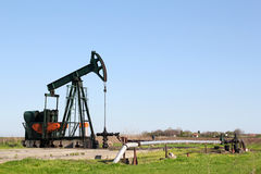 Oil field. With pump jack Royalty Free Stock Image