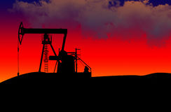 Oil field. On a dramatic sun-set Stock Photography