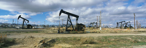 Oil field with black oil rigs Stock Photo
