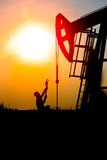 Oil field, the oil workers are working Stock Photos