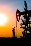 Oil field, the oil workers are working Royalty Free Stock Photography
