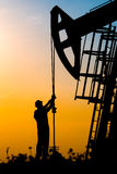 Oil field, the oil workers are working Stock Image