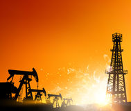 Oil field over sunset Royalty Free Stock Photo