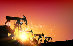 Oil field over sunset Royalty Free Stock Photos