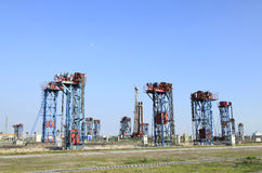 Oil field scen. E,tower type pumping unit in the work Royalty Free Stock Images