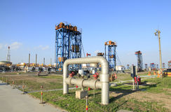 Oil field scen. E,tower type pumping unit in the work Stock Image
