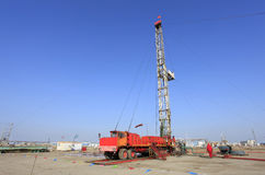 Oil field scen. E,tower type pumping unit in the work Royalty Free Stock Photography