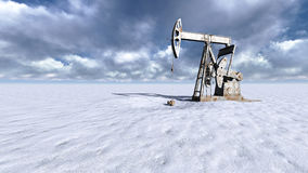 Oil field at  snow. Oil field pump jacks at  snow and clouds in background Stock Photo