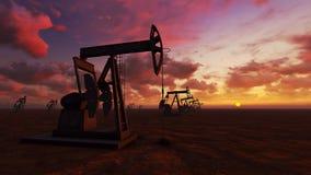 Oil field at  sunset. Oil field pump jacks at  sunset Stock Photos