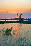 Oil field sunset Royalty Free Stock Photography