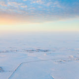 Oil field in tundra, top view. Aerial view of oil rig at an oil field in Western Siberia in the winter day Royalty Free Stock Photos