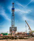 Oil field. The oil workers are working Stock Photos