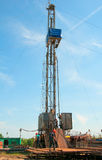 Oil field. The oil workers are working Stock Photo