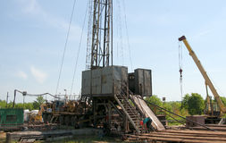 Oil field. The oil workers are working Stock Images