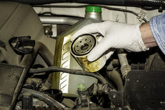 Oil filter and bottle in the engine compartment Royalty Free Stock Images