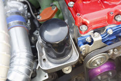 Oil filter on diesel racing car engine. Stock Photos